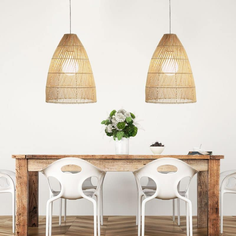 The Oden natural cane shade suspended over a dining setting