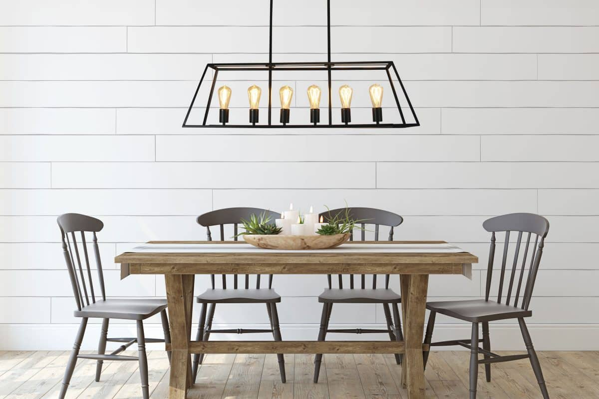 The Andrews Light Up Southport pendant hanging over a dining table.