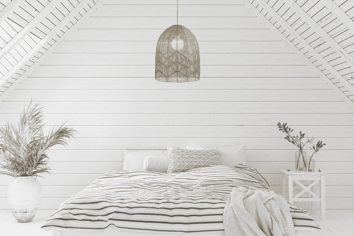 A hamptons style bedroom with the TANAH natural pendant shade displayed.